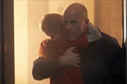 MIRAMAX - WHERE THERE'S SMOKE, THERE'S IRE A ticked - off Bruce Willis rescues young Jimmy Bennett from a - blazing fire in Hostage.