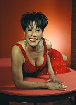 COURTESY DEPT 56 - Woman with the red dress on: Bettye LaVette.