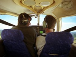 RADOK - Writer Sam Boykin and flight instructor Jon Long - enjoying the cozy environs of a Piper in flight.