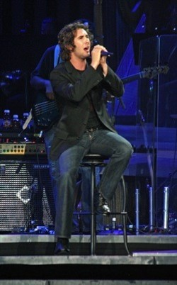 YOU RAISE HIM UP: Josh Groban performed his rescheduled concert at Charlotte Bobcats Arena on Sept. 2. Groban, who missed his original date due to illness, performed for two hours and donated the show's proceeds to music education at Charlotte-Mecklenburg Schools. - JEFF HAHNE
