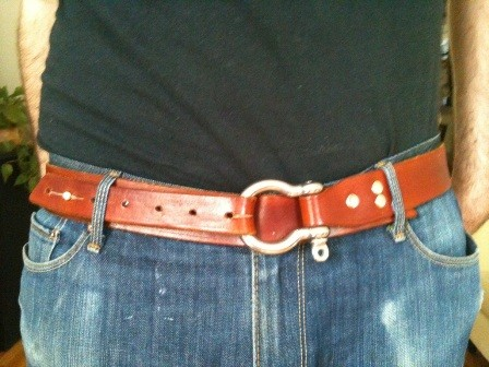 A belt with a nautical shackle as a buckle