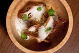 A bowl of fluffy riced potatoes is spiked with crispy shards of chicken skin and potato. - ANJALI M. PINTO ©LETTUCE ENTERTAIN YOU INC