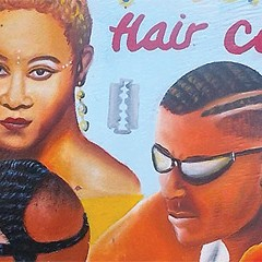 A collection of Ghanaian salon advertisements on display—in a salon