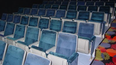A few rows of seats, sans rolled-up movie screen