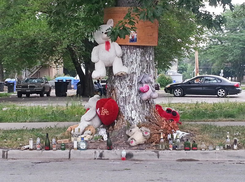 A makeshift shrine at 64th and May, in memory of a 22-year-old homicide victim