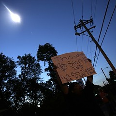 A police helicopter hovers above protesters in Ferguson, Missouri, in August.