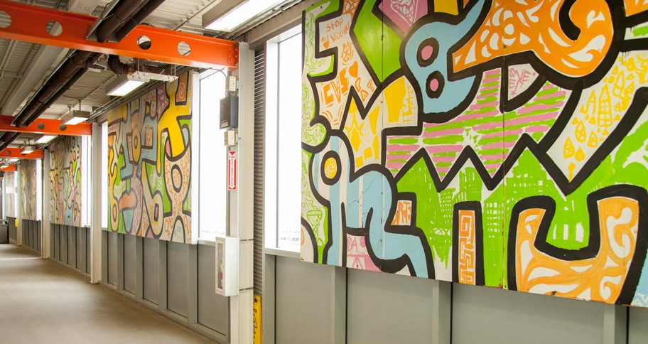 A portion of the mural is on display at Midway in a pedestrian tunnel between the CTA station and the main terminal. - PARKER BRIGHT