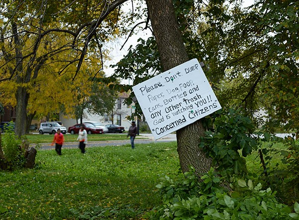 A sign posted in a vacant lot near the house Veronica Coney rents - MARZENA ABRAHAMIK