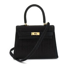 A vintage mini Kelly bag from Hermes, one of many items up for auction at Leslie Hindman Auctioneers.
