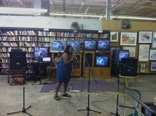 A woman sings R&B cover songs at a Salvation Army in Ann Arbor, Michigan