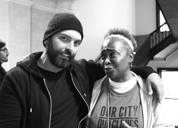 "Activist N'Dana Carter and fellow protester ""Mo"" at the Woodlawn mental health clinic. Mo turned out to be an undercover police officer named Mehmet Uygun."