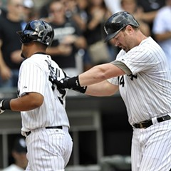 Adam Dunn gives Jose Abreu's back a high-ten as he makes sure he doesn't miss the plate Saturday, after hitting his final homer as a White Sox, against Detroit.