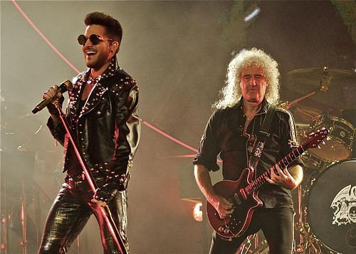 Adam Lambert is almost as fabulous as Brian Mays hair.