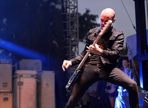 AFI bassist Hunter Burgan tests the structural integrity of his trousers.