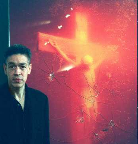 An AP photo of photographer Andres Serrano beside his photograph Piss Christ