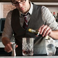 Step-by-step instructions for making a Graham Elliot Bistro bartender's Madras curry cocktail And three or four drops of the Madras curry tincture. Andrea Bauer