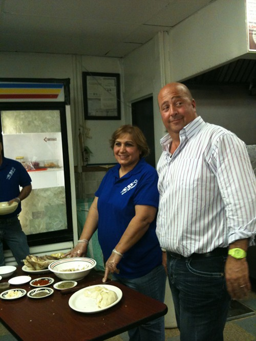 Andrew Zimmern and Basma Jajou stuffing stomachs at Georges Grill Kabab