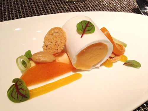 Apricot dessert inspired by the French dessert ile flottante (floating island).
