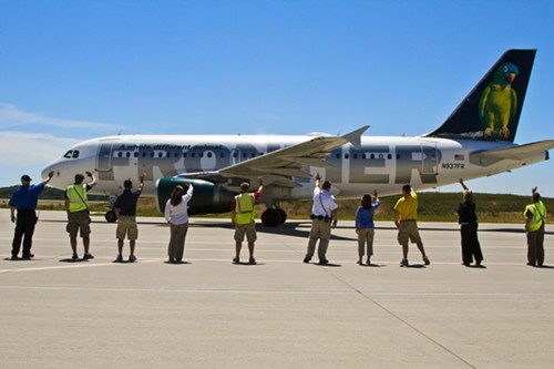 At the Branson airport, staffers greet or bid farewell to planes with the Branson Wave.