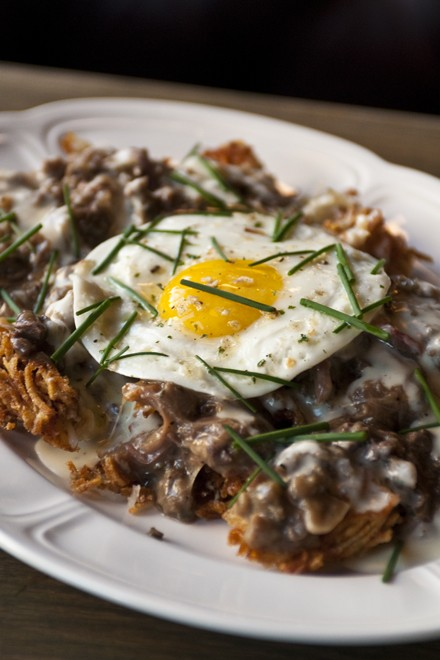 Au Cheval's potato hash with duck heart gravy - ANDREA BAUER