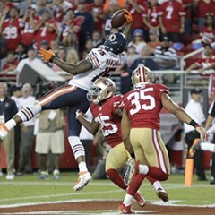 Brandon Marshall leaps and snares a second-quarter touchdown pass last night against the 49ers. He added two more TDs later.
