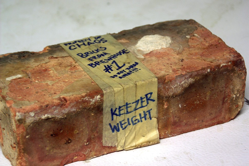 Bricks from the demolished CHAOS building in West Town hold the keezers temperamental lid closed.