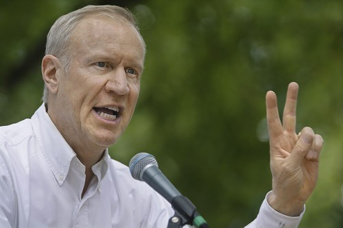 Bruce Rauner at the state fair in August. Yesterday he offered a second version of his stance on the minimum wage.