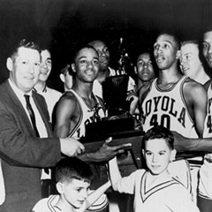 Captain Jerry Harkness holds the NCAA championship trophy after Loyola nips Cincinnati. To his left, coach George Ireland