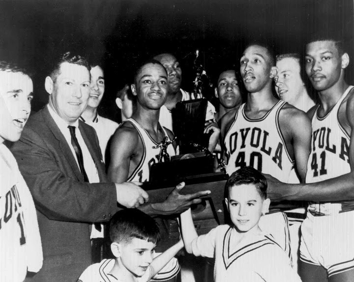 Captain Jerry Harkness holds the NCAA championship trophy after Loyola nipped Cincinnati on March 23, 1963. To his left, coach George Ireland.