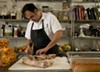 Chef Chris Pandel tends to pig trotters.