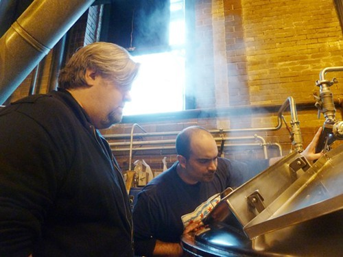 Chef Kevin Hickey of Allium brews beer with Jared Rouben at Goose Island in 2012.
