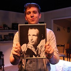 Chicago director Jake Fruend holding a photo of John, a mysterious friend from his grandmother's past.