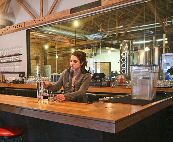 Chicago Distilling Company head bartender Shannon Bandur experiments behind the bar. - JULIA THIEL