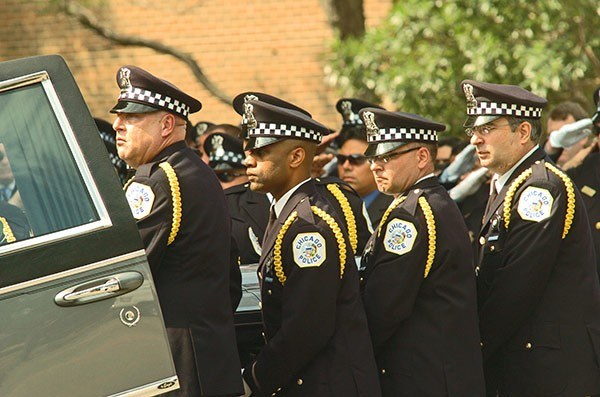 Chicago police officer Robert Soto's casket is placed into a hearse. Soto and a social worker, Kathryn Romberg, were killed in what police believe was a case of mistaken identity. - BRIAN JACKSON/SUN-TIMES