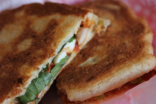 Chicken thigh panini on housemade bread, another signature item.