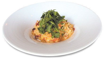 Crab risotto with Calabrian chiles, coconut milk, and dende oil