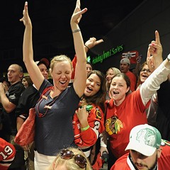 Dani Weadley, center left, of Fox Lake, and other Blackhawks fans at Harry Caray's Restaurant in Rosemont early Tuesday morning