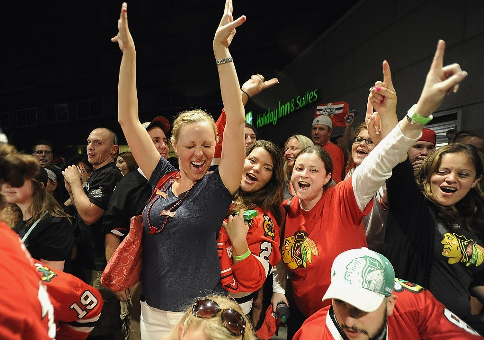 Dani Weadley, center left, of Fox Lake, and other Blackhawks fans at Harry Carays Restaurant in Rosemont early Tuesday morning