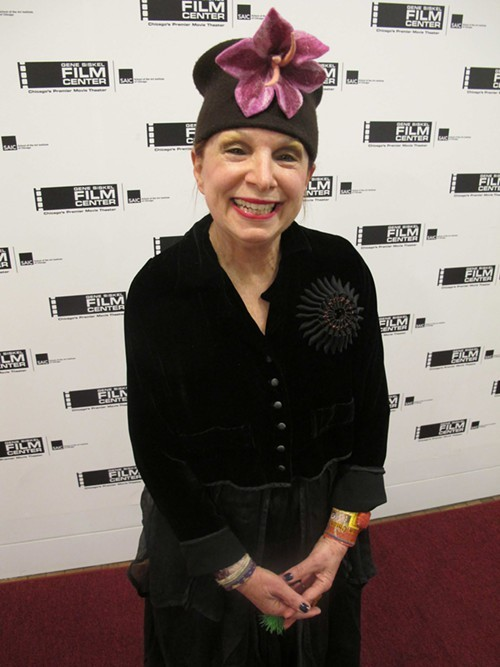 Darlene Schuff is wearing a velvet and tulle ensemble by local designer and SAIC alumnus Cynthia Ashby, a pin by Columbia college professor Beata Kania, and a hat by Diane Harty.