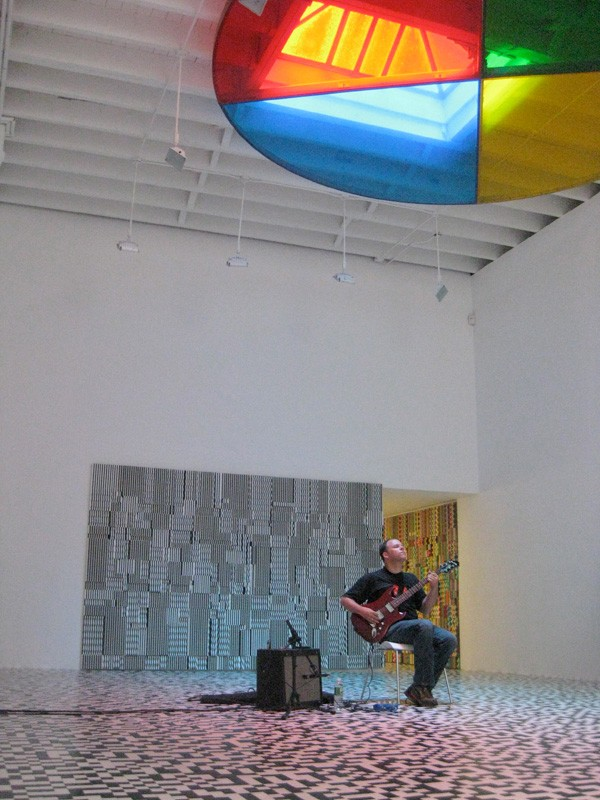 David Grubbs plays solo at New York's Deitch Projects gallery, beneath Peter Coffin's 2008 work Untitled (Color Wheel). - PETER COFFIN