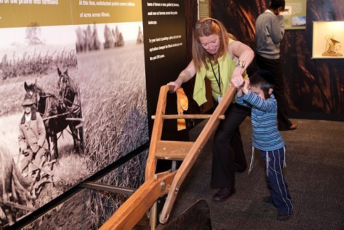 Deborah Lahey, the museums director, takes a turn at plowing the carpet.