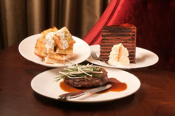 Delmonico steak, ciabatta with Wisconsin blue cheese fondue, 23-layer chocolate cake