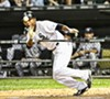 <em>Dewayne Wise Lays Down Bunt Single.</em> US Cellular Field, August. By Paul Boucher