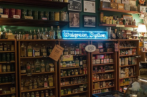 Display of vintage pharmaceutical bottles, some dating as far back as 1919