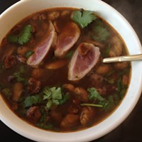 Gussied-up tom yam with duck breast and cracklings
