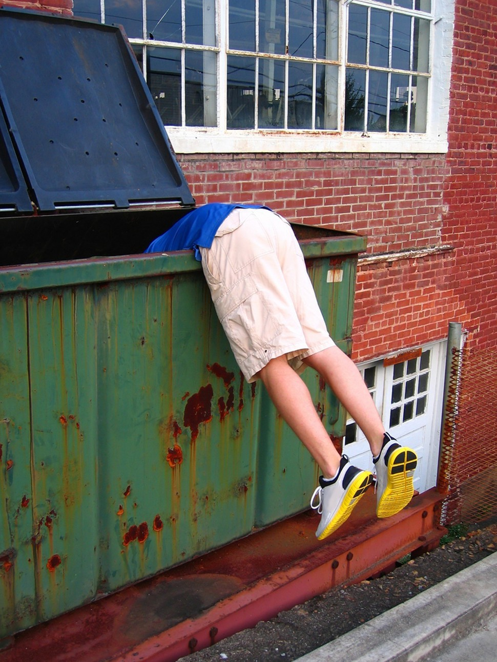 dumpster diving bleader image from shutterstock com