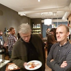 Ed Levine (in mid-chew of Great Lake Pizza) and Nick Kindelsperger at Serious Eats Chicago's launch party in 2011.