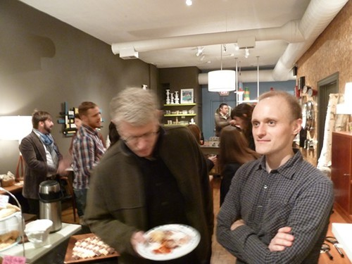 Ed Levine (in mid-chew of Great Lake Pizza) and Nick Kindelsperger at Serious Eats Chicagos launch party in 2011.