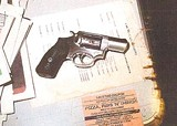 Evidence technician's photo of Alvin Weems's gun