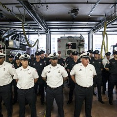 Firefighters stand at attention for a roll call during an open house celebration for the 100th anniversary of Chicago Fire Department's Squad 1.